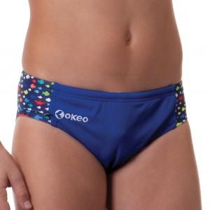 Costume slip per il nuoto da bambino. Colore blu con inserti laterali stampati con colori fluo. Resi