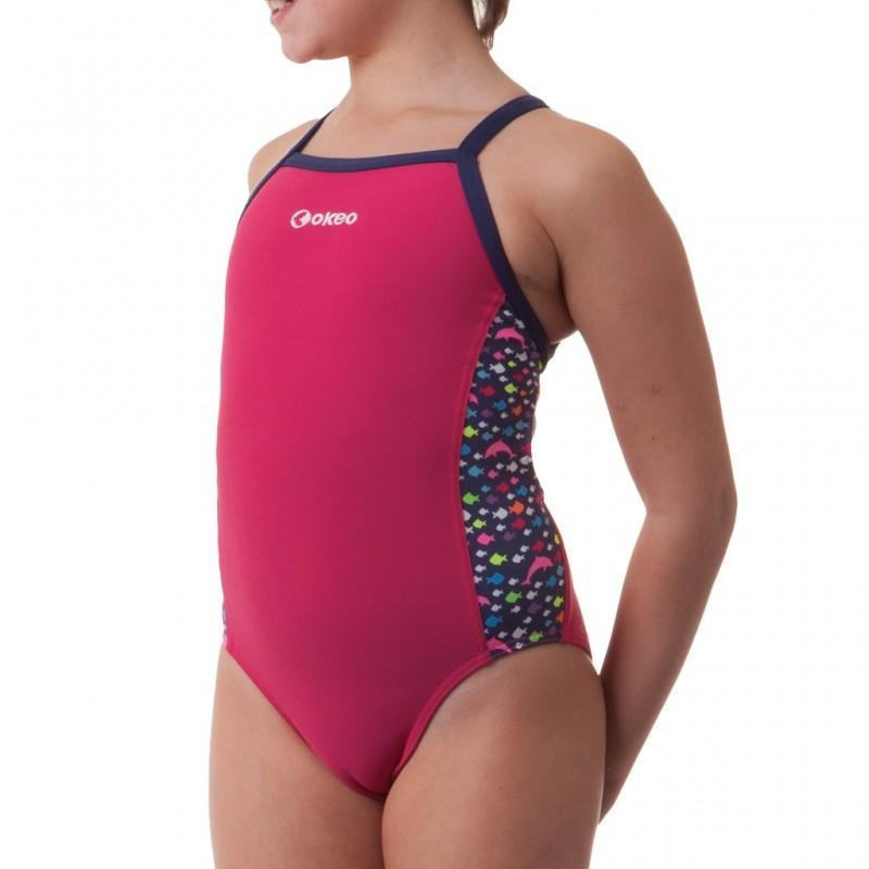 Costume intero da nuoto per bambina. Tinta unita con inserti laterali stampati con colori fluo.