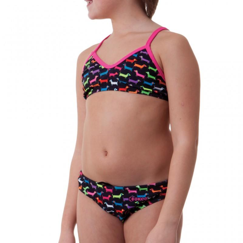 Costume due pezzi bambina ideale per la spiaggia e la piscina. Simpatica fantasia con colori fluo su